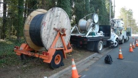 Spool of Fiber Optic Cable Being Laid